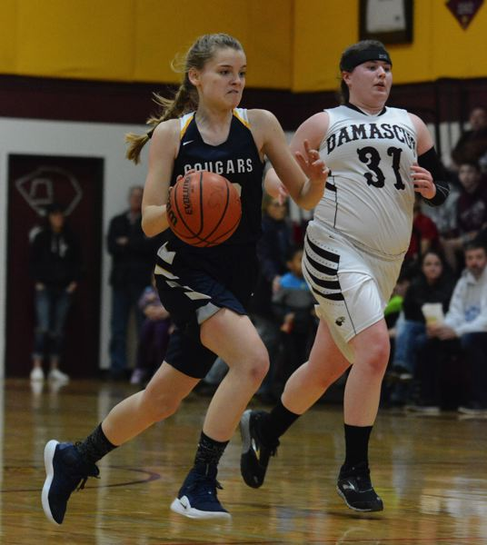 OUTLOOK PHOTO: DAVID BALL - Country Christians Lizzy Grandle moves down the floor on a fastbreak ahead of Damascus Christians Tory Webb.