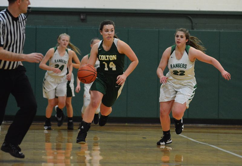 PAMPLIN MEDIA: DAVID BALL - Coltons Becca Burge beats a pack of Rangers down the floor on her way to a game-high 20 points in the teams 50-30 win at Estacada on Monday.