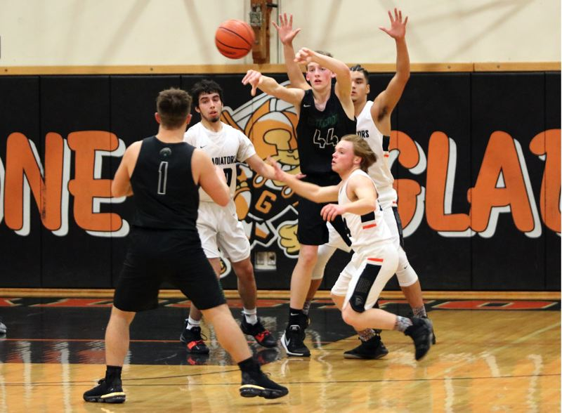 PAMPLIN MEDIA: JIM BESEDA - Estacada's Justin Lang (44) sends the ball from the low post to Nick Keller (1) as Gladstone defenders (left to right) Damian Zaines, Matthew Lehrbach, and Jeremy DeVoe adjust Wednesday.