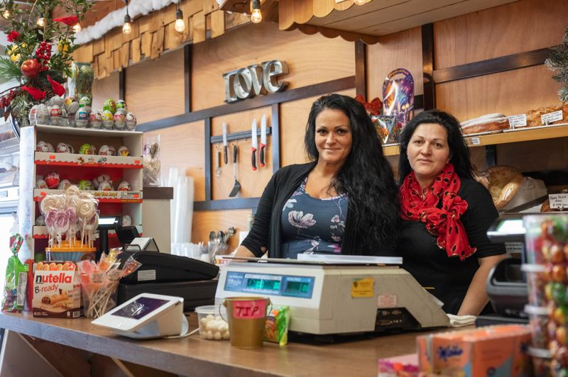 TRIBUNE PHOTO: JONATHAN HOUSE - Elena Vykhovanets, owner operator of Russian Elegant Food, and her sister Tatiana Shibitov, who works with her. Staff work through the night making pastries and fresh deli food based on Slavic recipes. The fried pie-like piroshkis are particularly popular, and Vykhovanetss  posts on Snapchat and Instagram often bring in customers.