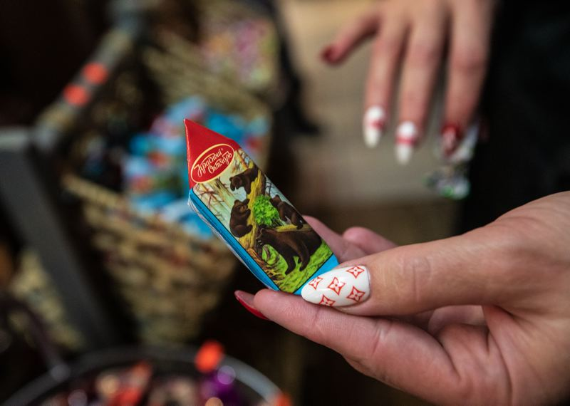 TRIBUNE PHOTO: JONATHAN HOUSE - Russian Elegant Food has a wall of Russian candies such as cosolapa mishka (little bear with crooked feet) and aromashka (daisies).