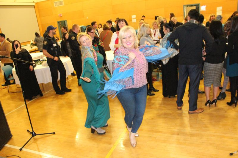 PHOTO: ANASTASIA PUZUR) - Guests dance at a Slavic and Eastern European cultural celebration at IRCO on Northeast Glisan Street just blocks from Russian Elegant Food. Vykhovanets cooked and donated food but was too busy to attend.