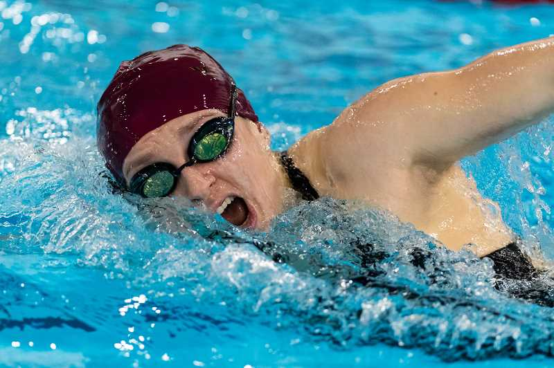 STAFF PHOTO: CHRISTOPHER OERTELL - Forest Grove High School's Daphne Janko competed in a swim meet against McMinnville High Schoolat the Forest Grove Aquatic Center in Forest Grove, Ore., on Thursday, Jan. 17, 2019.