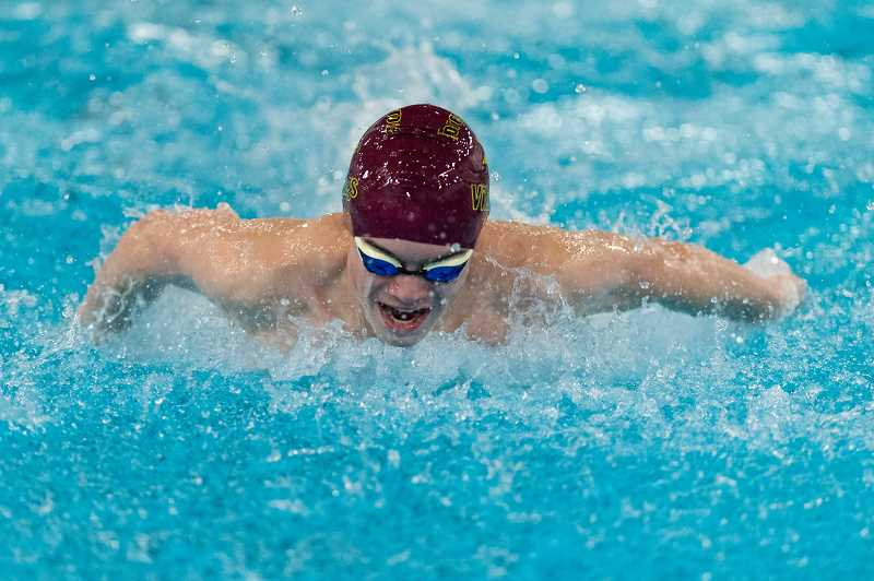 STAFF PHOTO: CHRISTOPHER OERTELL - Forest Grove High School's Hunter Bartoo competed in a swim meet against McMinnville High School at the Forest Grove Aquatic Center in Forest Grove, Ore., on Thursday, Jan. 17, 2019.