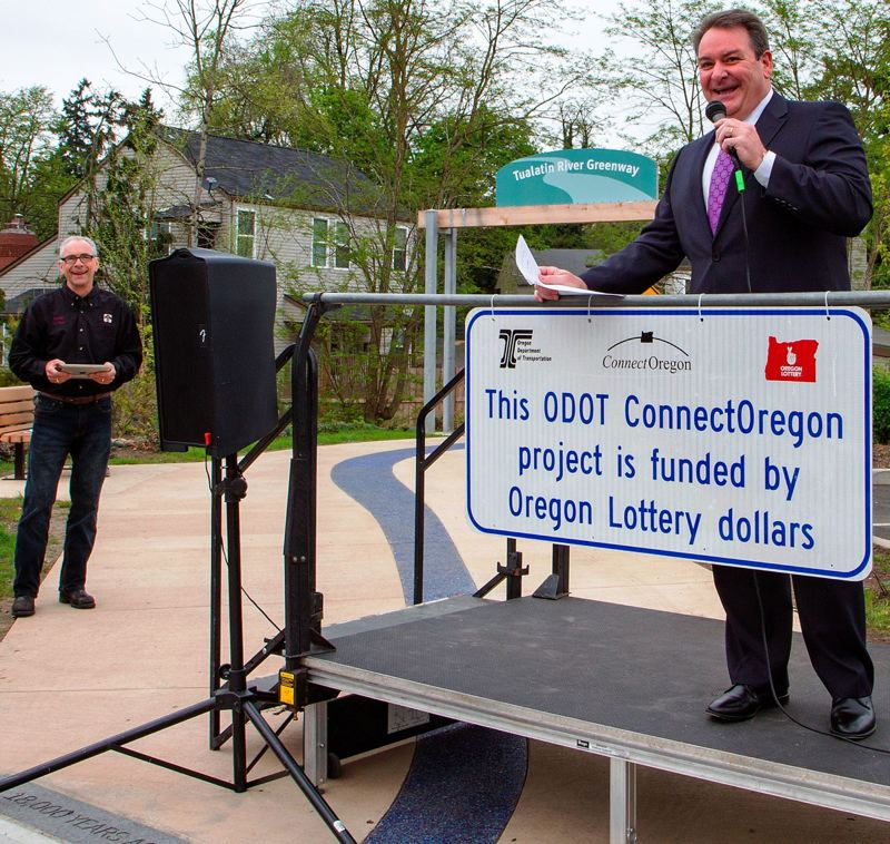 PAMPLIN MEDIA GROUP FILE PHOTO - Matt Garrett, director of the Oregon Department of Transportation, said Jan. 18 that he will step down after the 2019 legislative session ends. Garrett, right, appeared at an event with then-Tualatin Mayor Lou Ogden