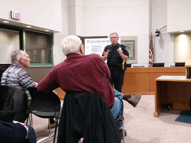 TIMES PHOTO: RAY PITZ - Lt. Neil Charlton, a Tigard police traffic enforcement team supervisor, explains how the upcoming photo traffic enforcement, which initially will be used to ticket red-light runners, will work.