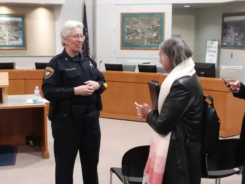 TIMES PHOTO: RAY PITZ - Chief Kathy McAlpine chats with a resident following her regular Chiefs Chat, which was held Wednesday.
