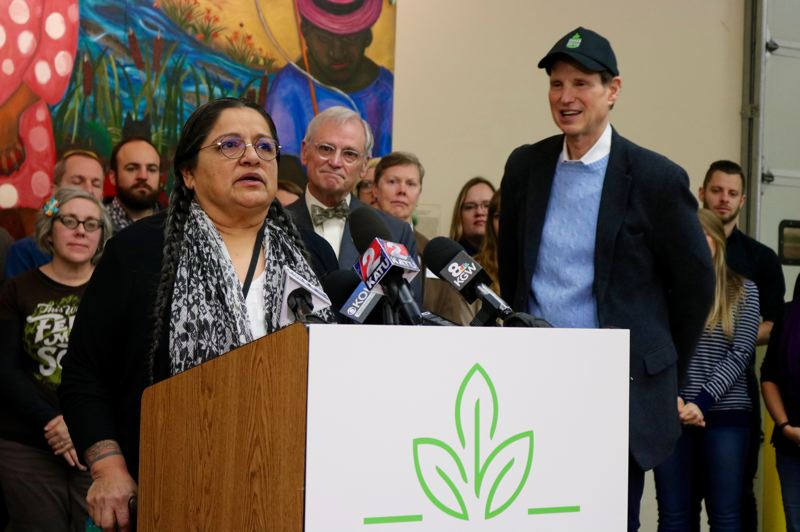 TRIBUNE PHOTO: ZANE SPARLING - U.S. Sen. Ron Wyden and Congressman Earl Blumenauer listen to a speech by State Rep. Tawna Sanchez during a press conference at the Oregon Food Bank on Friday, Jan. 18.