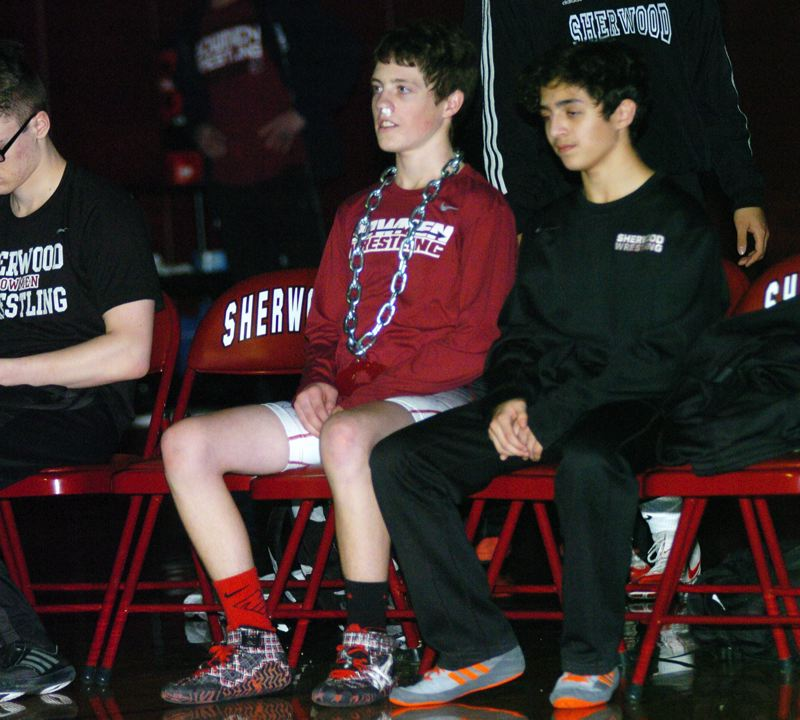 TIMES PHOTO: DAN BROOD - Sherwood junior Nick Hekker got to wear the 'Pin Chain' after winning the 113-pound match by fall during the Bowmen's win over Century.