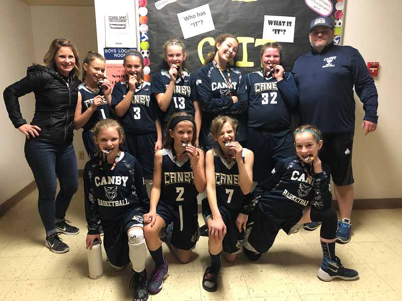 KRISTEN WOHLERS - Pictured is one of Canby's sixth-grade junior basketball teams after winning a tournament in December.