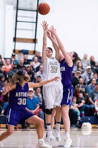 STAFF PHOTO: CHRISTOPHER OERTELL - Banks' Maddy Shook goes up for a shot during the Braves' game against the Fishermen Friday, Jan. 18, at Banks High School.