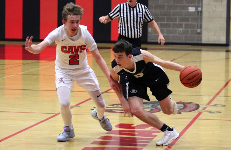 PAMPLIN MEDIA: JIM BESEDA - Gresham's Eric Puclic drives around Clackamas' Damon Erickson late in the second quarter of the Gophers' 61-60 Mt. Hood Conference boys' basketball win Friday at Clackamas High School.