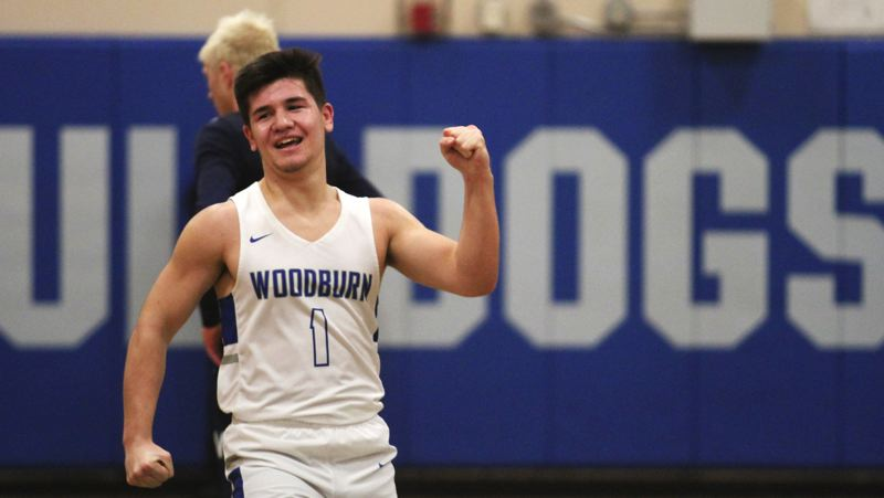 INDEPENDENT PHOTO: PHIL HAWKINS - Woodburn's Trevor Karsseboom celebrates during his team's key 60-59 home win over Newport on Friday night.