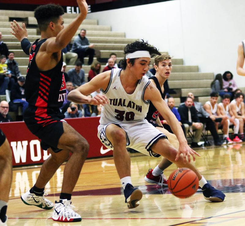 TIMES PHOTO: DAN BROOD - Tualatin senior Bridger Steppe looks to make a move to the basket during Friday's game with Oregon City.