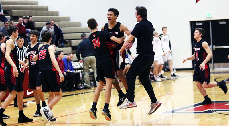TIMES PHOTO: DAN BROOD - The Pioneers celebrate following their 61-60 win over Tualatin in Friday's Three Rivers League game played at Tualatin High School.
