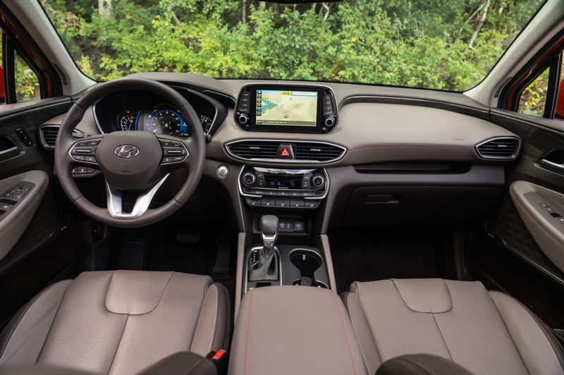 HYUNDAI MOTOR AMERICA - The interior of the 2019 Hyundai Santa Fe is modern, with an available large display screen, leather seats, and the latest technologies.