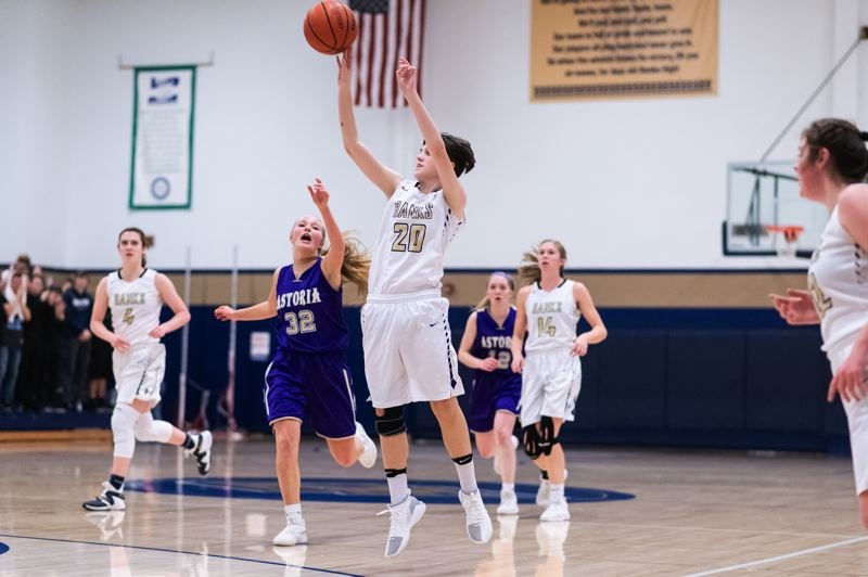TRIBUNE PHOTO: CHRISTOPHER OERTELL) - Banks High School's Maddy Shook launches a shot during her team's Friday home win over Astoria High School at Banks High School.