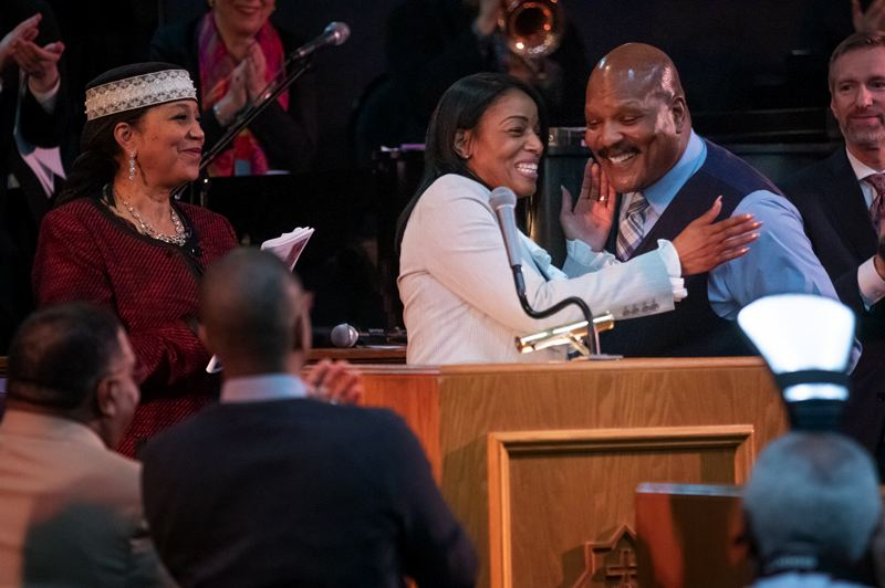 TRIBUNE PHOTO: JON HOUSE - Elder Twauna Hennessee hugs Pastor J.W. Matt Hennessee during the Drum Major Celebration at the Vancouver Avenue First Baptist Church.
