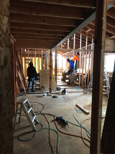 COURTESY PHOTO: REGENCY MANAGEMENT INC. - A construction crew works on converting a commercial building at the Garden Court Plaza in Forest Grove into the Garden Court Lofts apartments.