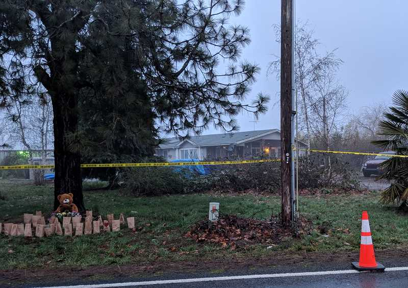 CANBY HERALD/MOLALLA PIONEER: JOHN BAKER - A memorial for the four family slain family members has been erected by supporters at the scene of the crime outside Woodburn.