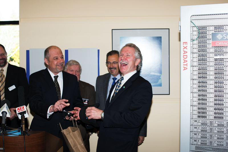 FILE PHOTO - Gov. John Kitzhaber laughs as he is gifted a Oracle Team USA hat by Oracle Vice President Luke Kowalski. Behind them from left are Washington County Chair Andy Duyck, Metro President Tom Hughes and Hillsboro Mayor Jerry Willey.