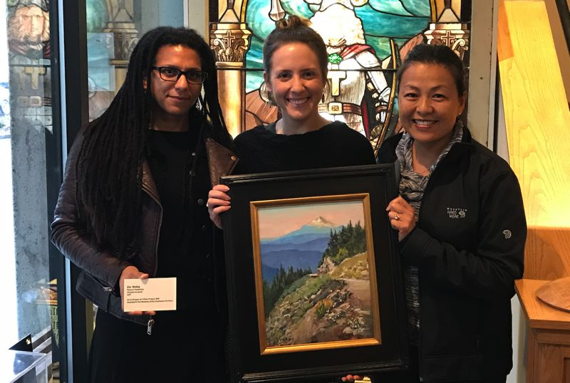 SUBMITTED PHOTO - Left to right, Tammy Jo Wilson, AiO; Jenna Barganski, Clackamas County Historical Society; and Elo Wobig, artist, with her painting 'Road to Timberline.'