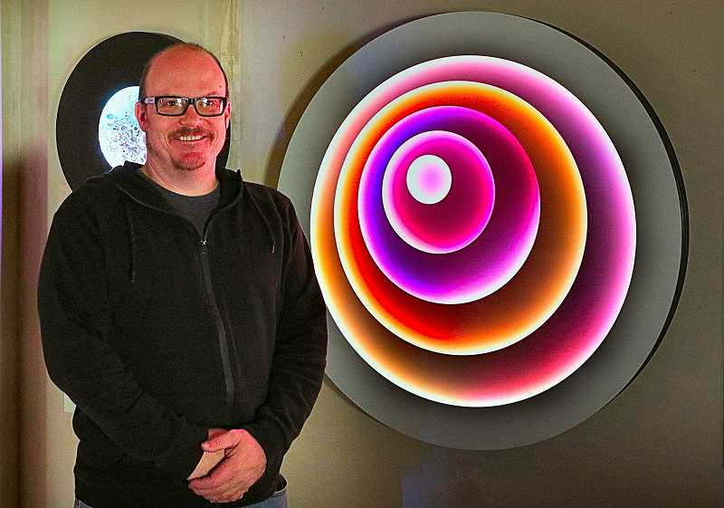 DAVID F. ASHTON - Light Artist Craig Dorety, with one of his illuminating works.