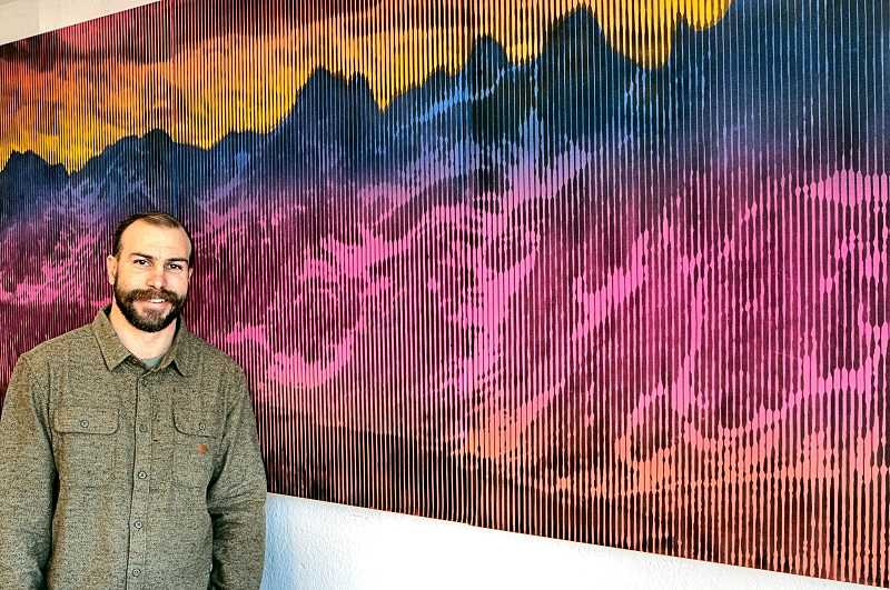 DAVID F. ASHTON - Spray-can artist Rudi Broschofsky shows his work entitled The Sawtooths.