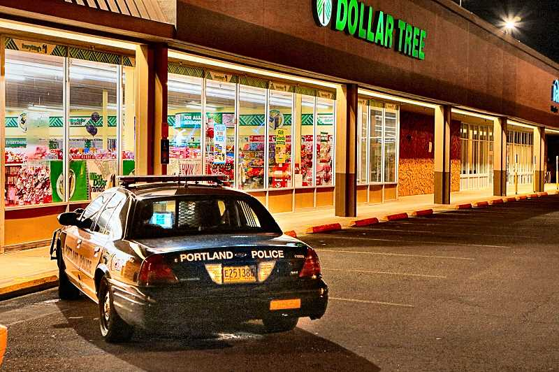 DAVID F. ASHTON - Inside this Foster Road Dollar Tree store, an officer debriefs the clerk whod been robbed by a knife-wielding, underwear-masked robber. Unfortunately, we cannot show you the bad guy in his unusual disguise, since he was long gone (in his long johns?) at this point.