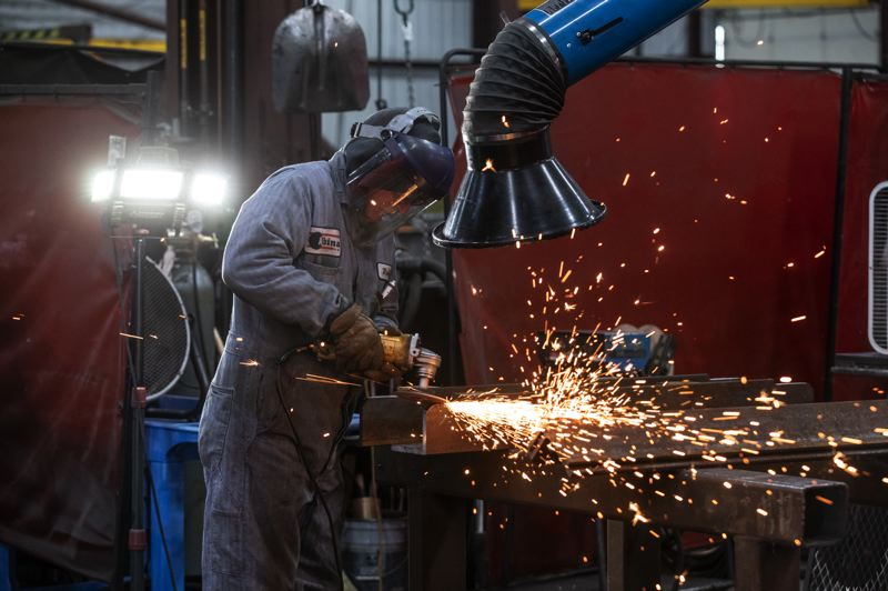 TRIBUNE PHOTO: JONATHAN HOUSE - Grinding and welding are among the services Albina Co. provides for its clients.