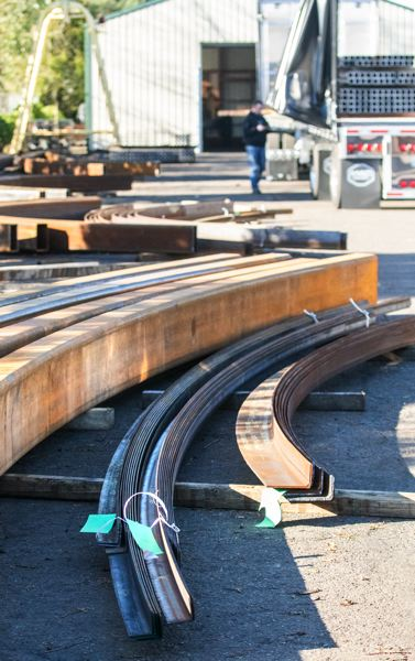 TRIBUNE PHOTO: JONATHAN HOUSE - Finished bent steel waits to be shipped at Albina Co.