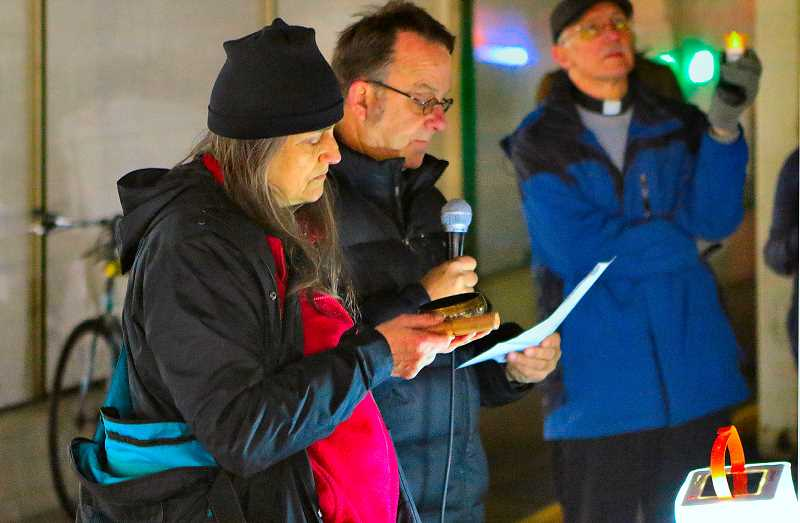 DAVID F. ASHTON - Ringing a bell as they alternated reading names of homeless people who have recently died in Portland were Alys Allwardt from Pilgrim Lutheran Church in Lents, and Paul Underwood, director of Operation Nightwatch.