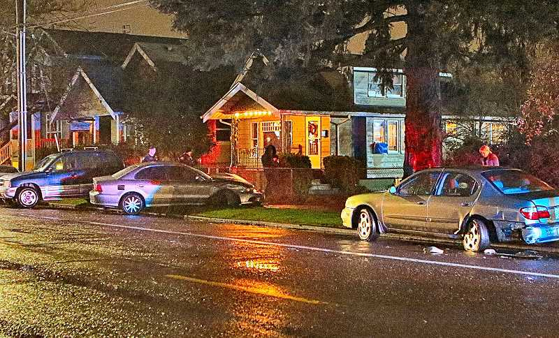 DAVID F. ASHTON - For reasons unknown, these three vehicles became entangled on Woodstock Boulevard in a rainstorm on January 16, and two wound up on the sidewalk.