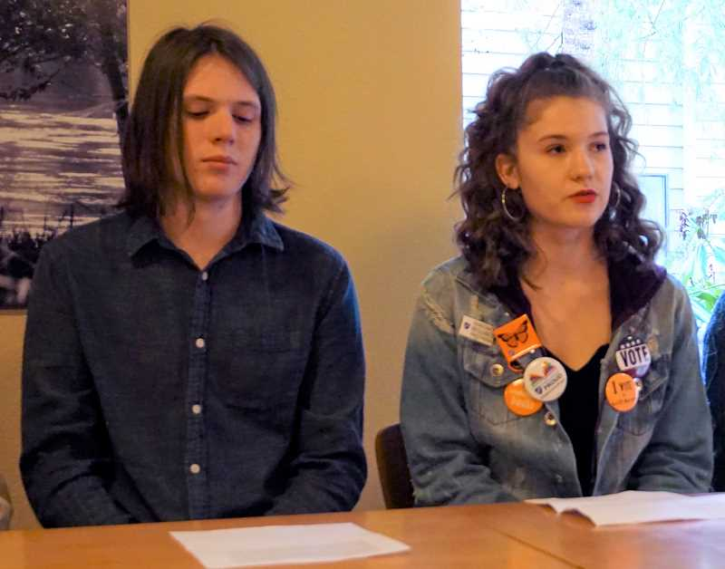 REVIEW PHOTO: CLAIRE HOLLEY - High school students Eli Counce (eft) and Eliana Andrews answer questions at Sunday's press conference. Here, Andrews describes her experience with school lockdown drills.