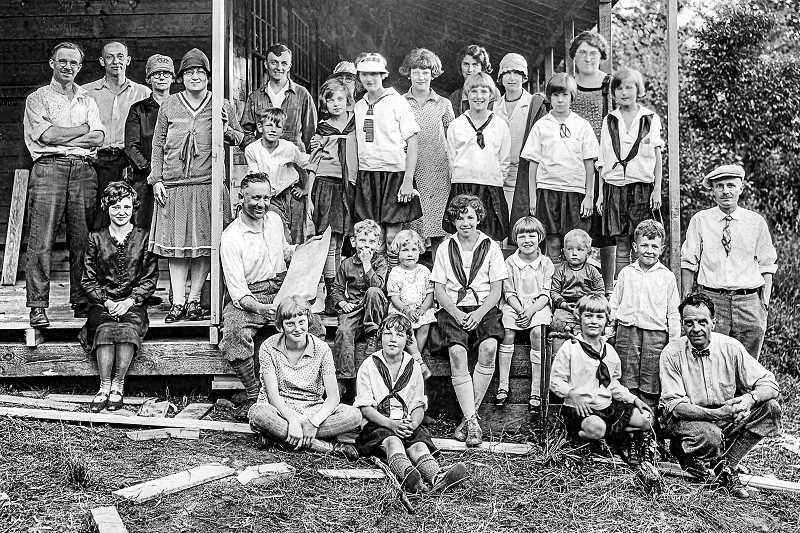 COURTESY OF KIWANIS CLUB OF PORTLAND - This 1928 photo was taken at the Campfire Girls local Camp Namanu, showing Kiwanis Club members, their families, and camp counselors. Every summer volunteers from Kiwanis were at the camp - building, repairing, and adding needed fixtures. Kiwanis Club members also sponsored any girls unable to afford the summer camp fees.
