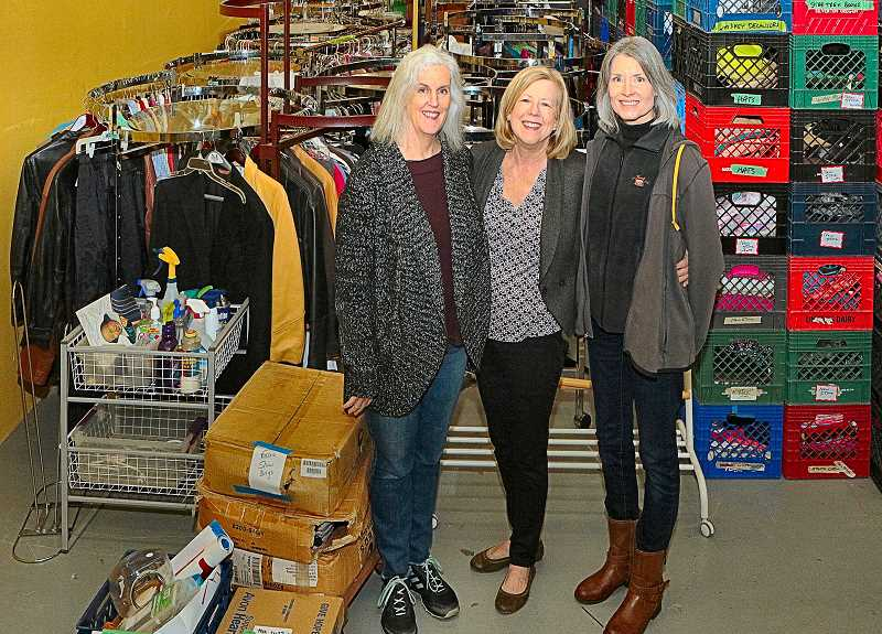 DAVID F. ASHTON - Sams Attic Eclectic Thrift Co-Manager Patty Pullen, stands with longtime volunteer Lori Johnson and new helper Linda McNulty, amid some of the merchandise about to be trucked to the stores new location in Beaverton.