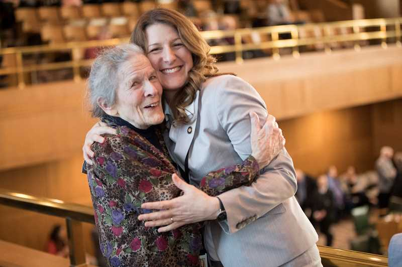 SPOKESMAN PHOTO: JAIME VALDEZ - Wilsonville representative Courtney Neron hugs Nancy Tracy, who was her second grade teacher at Metzger Elementary School. Tracy was in attendance for Nerons first day in office.