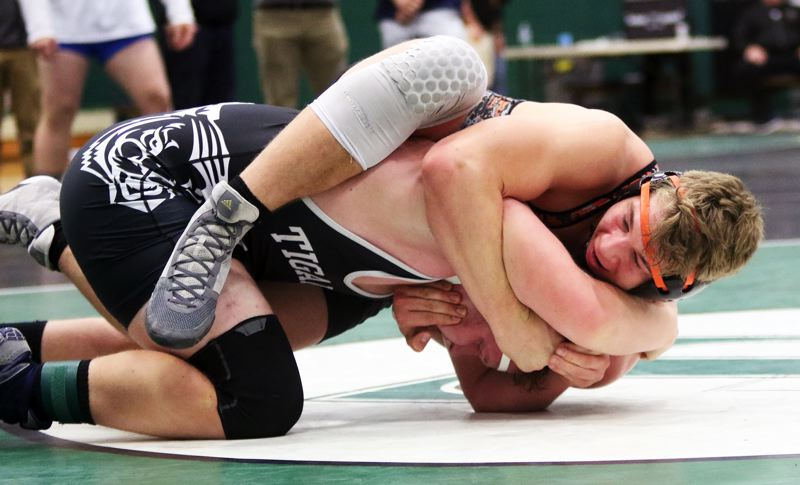 TIMES PHOTO: DAN BROOD - Beaverton High School junior Sandrey Mitberg has control in the final moments of his match with Tigard's Carter Dennis at Saturday's Tigard Tournament.