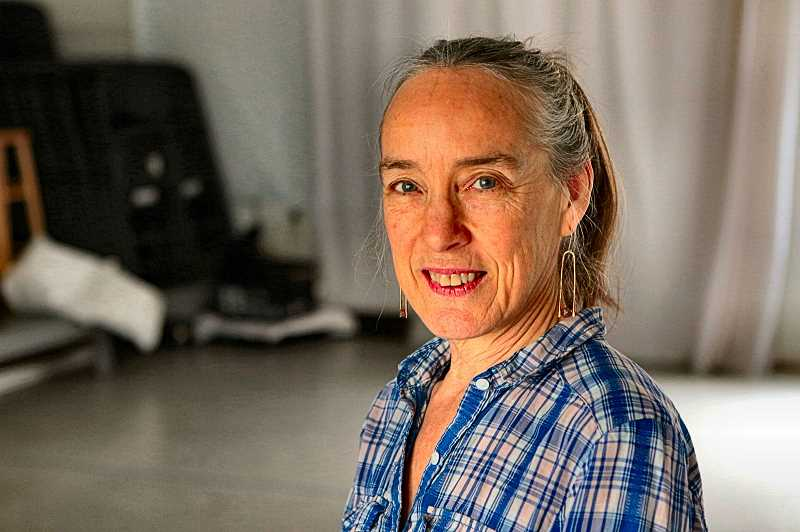 DAVID F. ASHTON - Taking a break in her Foster-Powell studio while preparing for her solo dance project Ordinary Devotions, is Oregon Arts Fellowship award recipient Linda Austin.