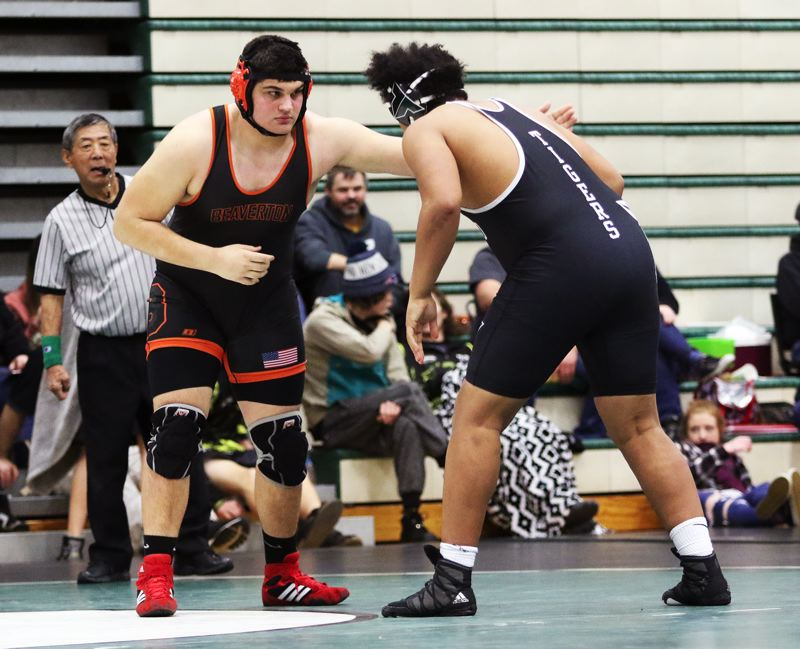 TIMES PHOTO: DAN BROOD - Beaverton senior Ryan Turner (left) battles Tigard's Jonny Nomani in the 285-pound fifth-place match at Saturday's Tigard Tournament.