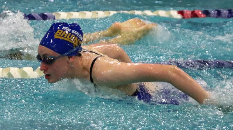 PAMPLIN MEDIA: JIM BESEDA - Barlow's Kaselyn Markell powers through the water in the butterfly during the Bruins dual-meet loss at Clackamas on Friday.