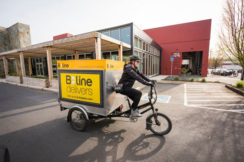 COURTESY: THE REDD - A courier sets out with deliveries from B-Line Sustainable Urban Delivery from The Redd on Salmon Street campus, which now services many producers and consumers.