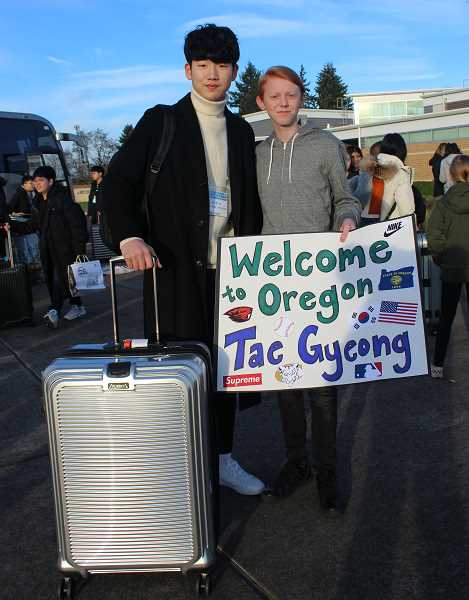 KRISTEN WOHLERS - Baker Prairie student Colby Beck (right) welcomes his guest Tae Gyeong from Changwon, South Korea.