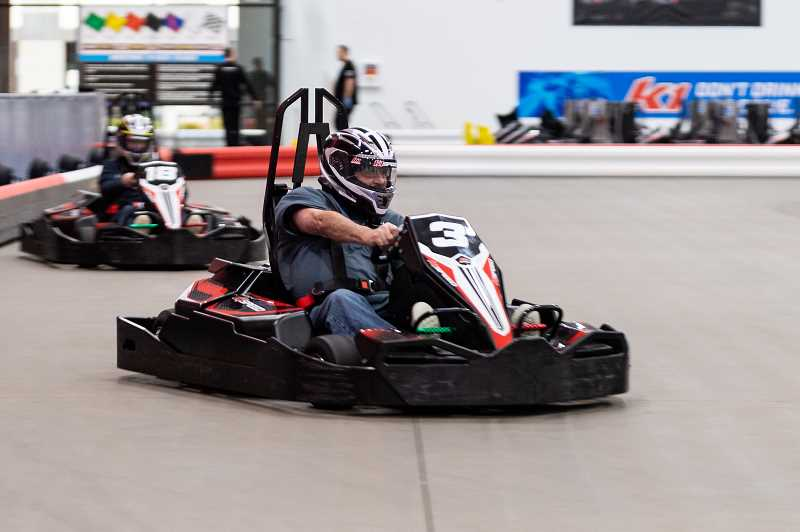 STAFF PHOTO: CHRISTOPHER OERTELL - Racers compete with one another in electric go-karts around the track at K1 Speed in Hillsboro on Thursday, Jan. 17.