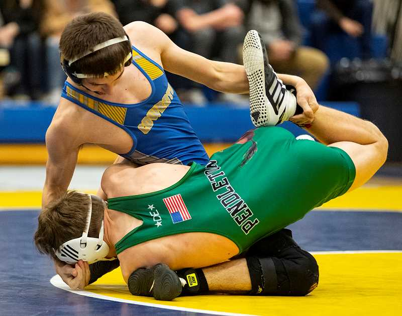 LON AUSTIN/CENTRAL OREGONIAN - Tannon Joyner works to control Pendleton's Kellen Hanson during Thursday night's Mike Shinkle Memorial Duals, which were held in Prineville. Joyner won the match by first-round fall.