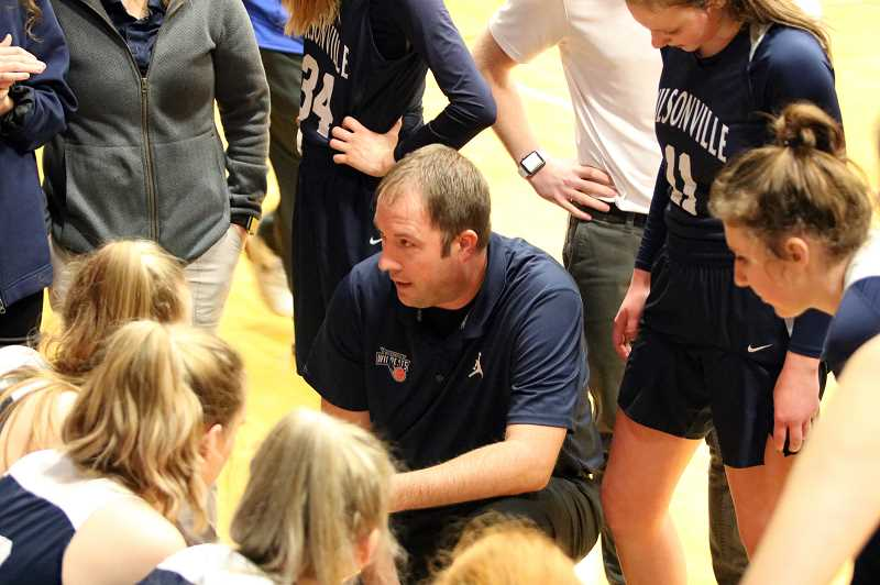 PAMPLIN MEDIA GROUP PHOTO: JIM BESEDA - Wilsonville coach Justin Duke talks strategy during pre-game warmups Tuesday