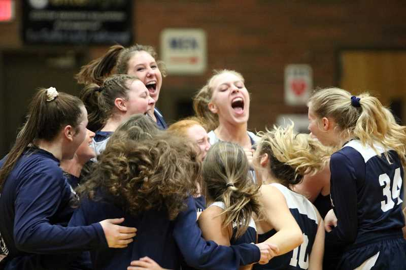 PAMPLIN MEDIA GROUP PHOTO: JIM BESEDA - Wilsonville girls get fired up before Tuesdays opening tip at La Salle Prep.​