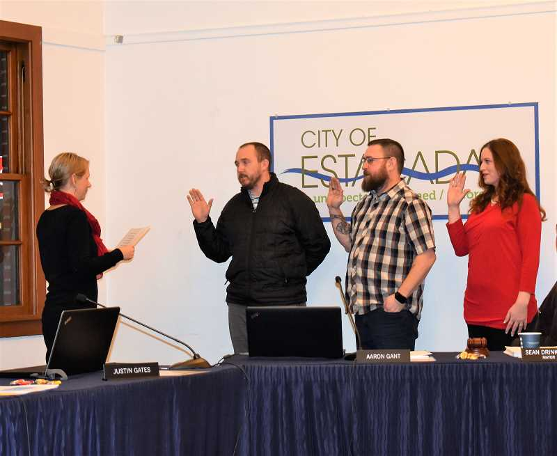 ESTACADA NEWS PHOTO: EMILY LINDSTRAND - Estacada City Recorder Sadie Main leads councilors Justin Gates, Jerry Tenbush and Katy Dunsmuir in the oath of office during a meeting on Monday, Jan. 14.