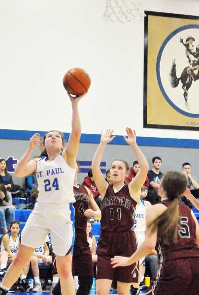 GARY ALLEN - Senior Emma Connor attacks the basket in St. Paul's 45-15 win over Perrydale on Monday..