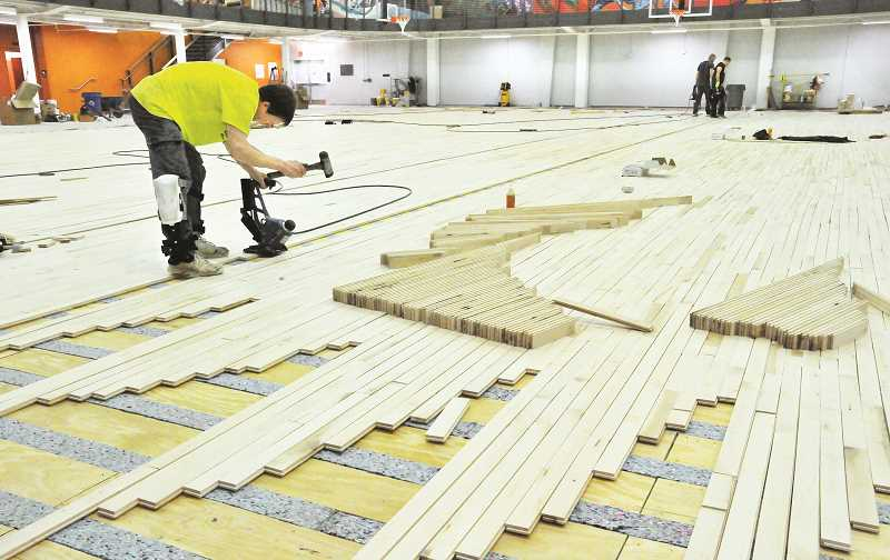 GARY ALLEN - A contractor was on hand last week to begin installing the maple flooring on the gymnasium floor at the renovating fitness center.